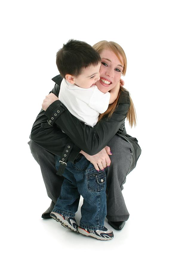 Nanny hugs little boy